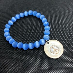 Jewelry - Blue bead bracelet with silver peace charm
